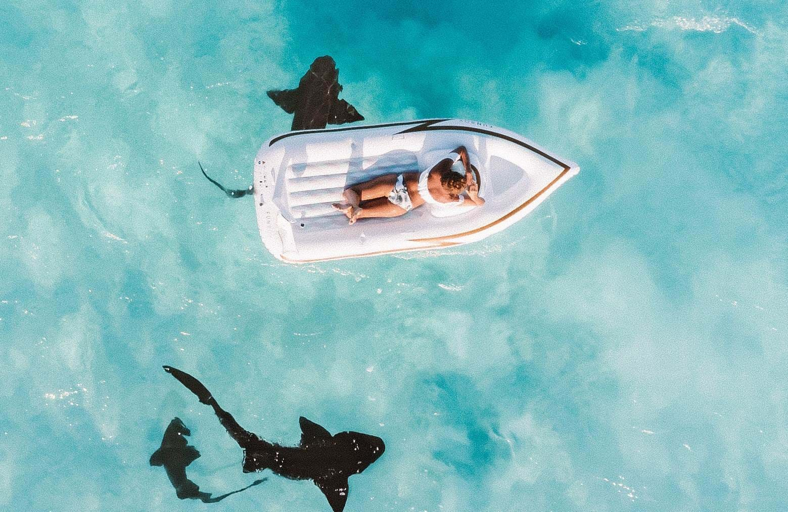 bahamas-woman-ocean-rays-cover
