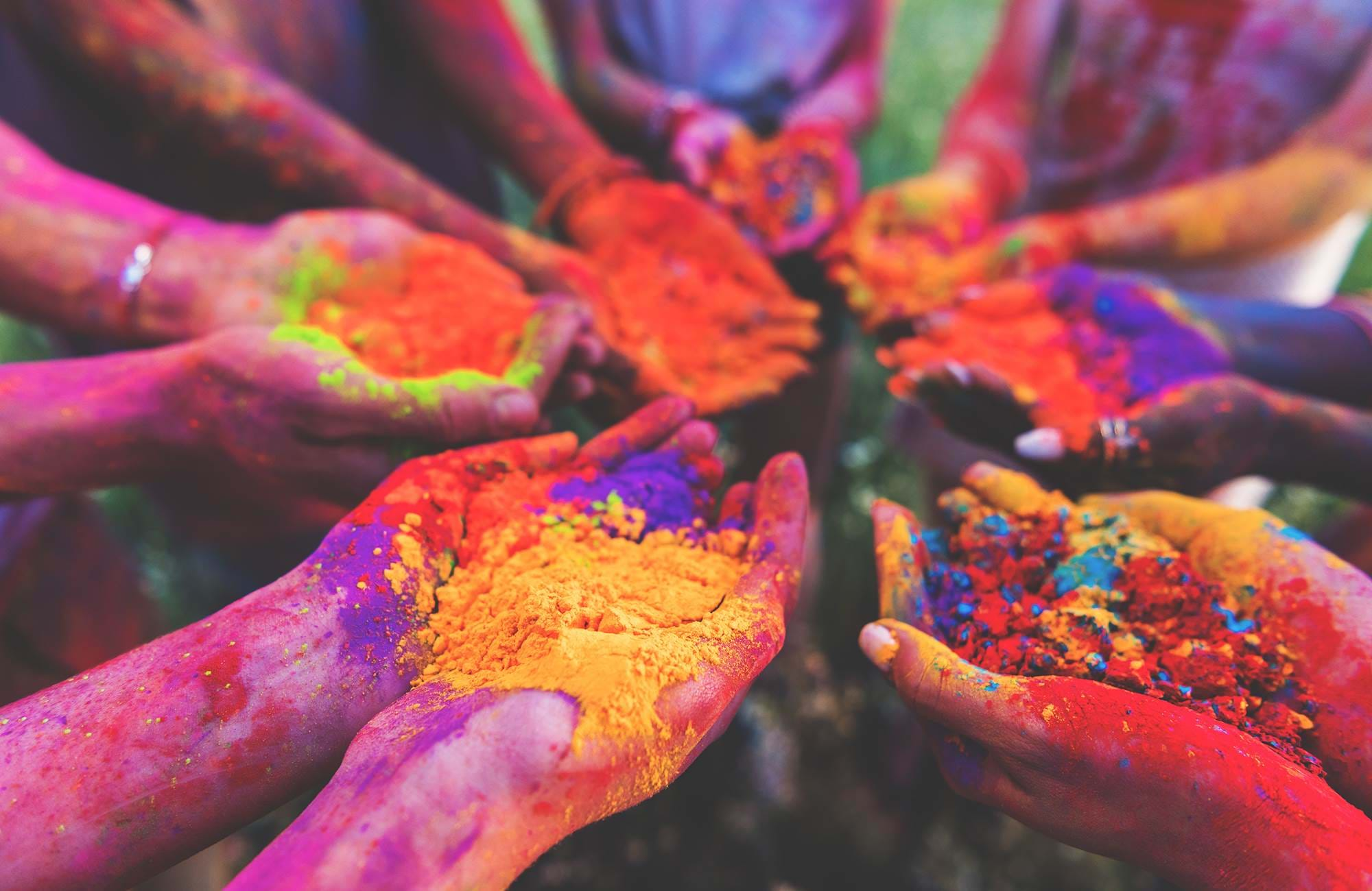 india-holi-festival-hands-holding-colors